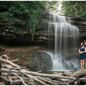 Romantic couple engagement photos in front of waterfall in Hamilton