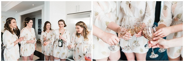 Bride popping champagne bottle with bridesmaids in kitchen of Four Season Hotel Private Residences