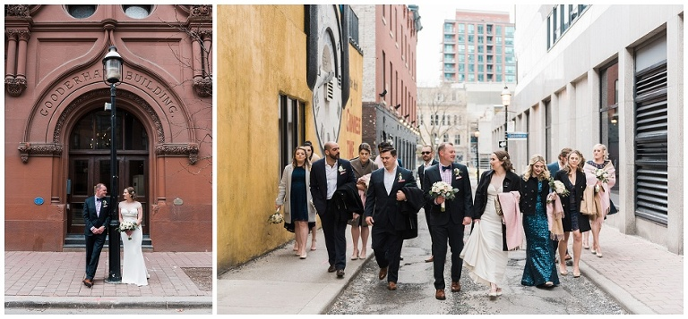 Wedding party walking down Toronto street by the Gooderham Building for wedding photographs