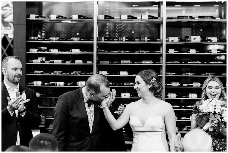 Groom kissing brides hand at jump restaurant wedding
