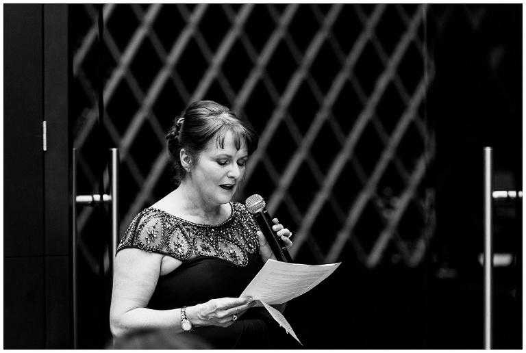 Mother of the Bride reciting speech at jump restaurant wedding