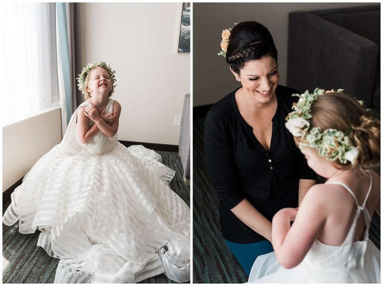 Bride's daughter trying on mom's wedding dress before Kurtz Orchard wedding