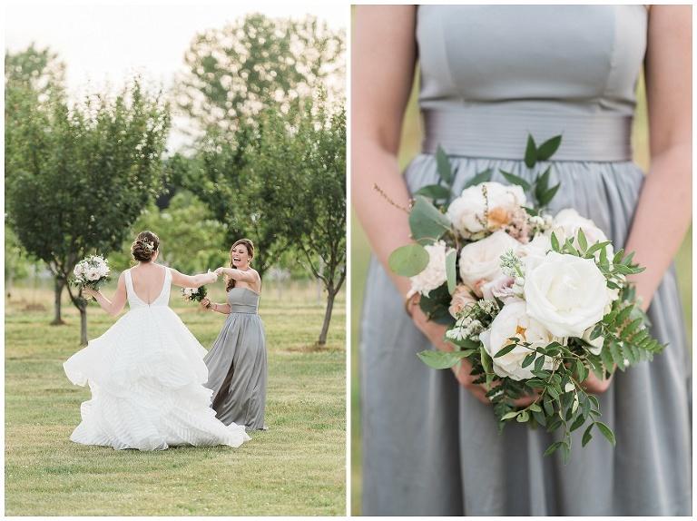 Bride & bridesmaid frolicking near orchard at Kurtz Orchard wedding