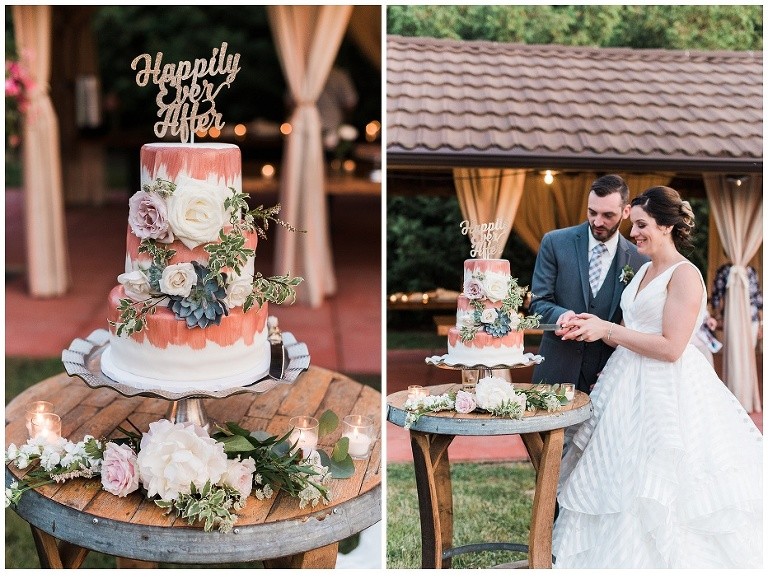 Bride and groom cutting wedding cake that is covered in fresh florals and succulents outside at Kurtz Orchard wedding