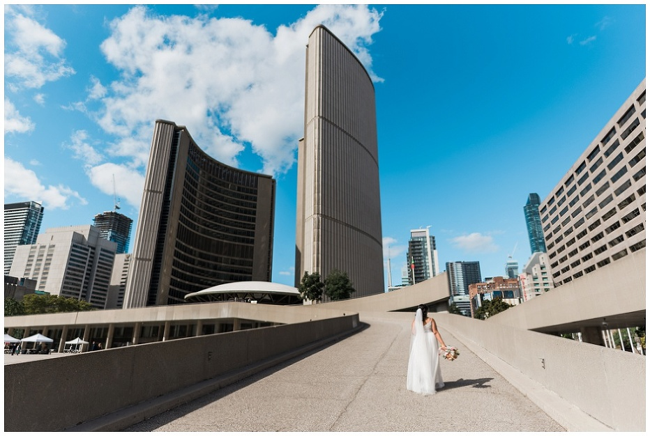 Bride walking up the ramp at Toronto City Hall on her way to the ceremony
