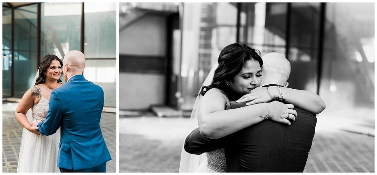 Bride hugging groom during first look outside of city hall, she is very emotional