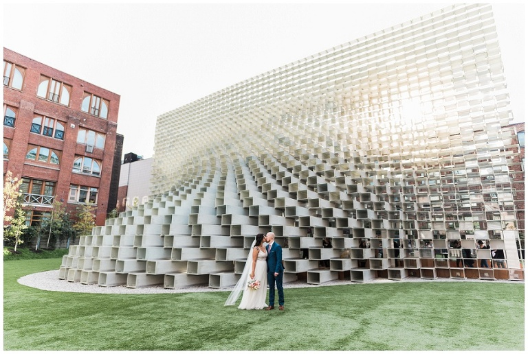 Bride and groom standing in front of architectural wonder Unzipped in Toronto