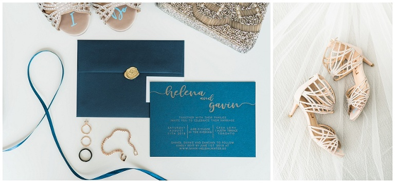 Navy and gold wedding invitation suite laying on white table with bride's wedding details surrounding it