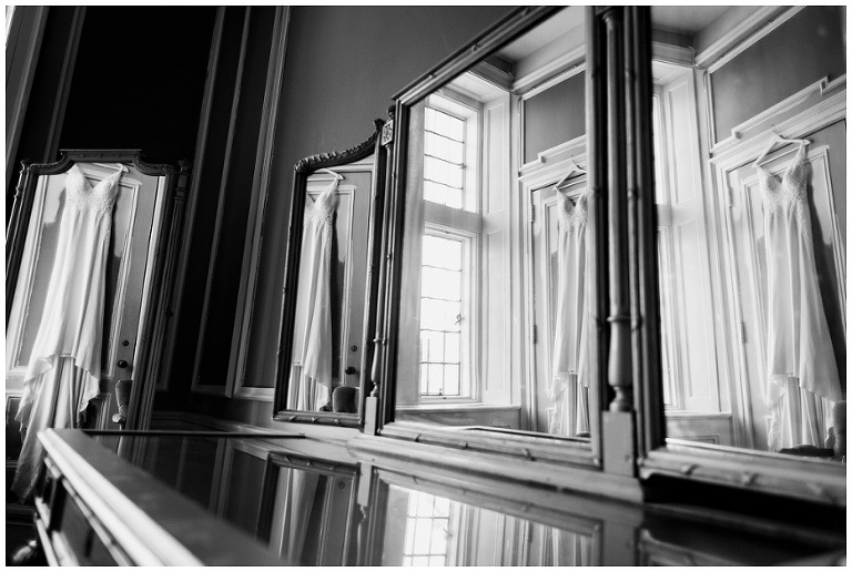 Bride's wedding dress reflected in 4 mirrors in bridal suite at Casa Loma
