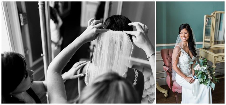 Bridesmaid putting on veil, bride sitting on chair for wedding portrait
