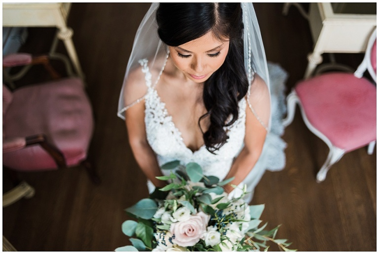 Above photo of bride holding her flowers in bridal suite at Casa Loma