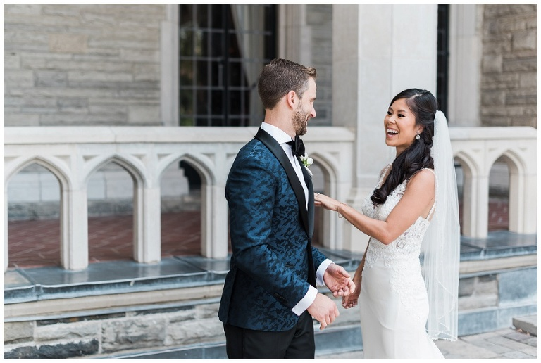 Bride and groom see each other for the first time on their wedding day with excited smiles