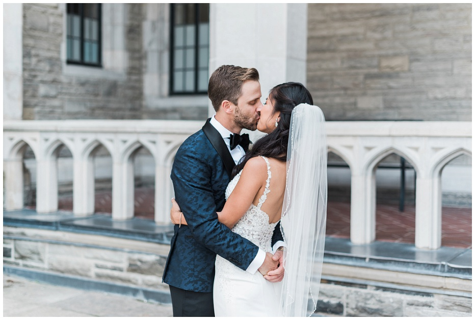 Groom kisses bride for the first time on their wedding day at Casa Loma