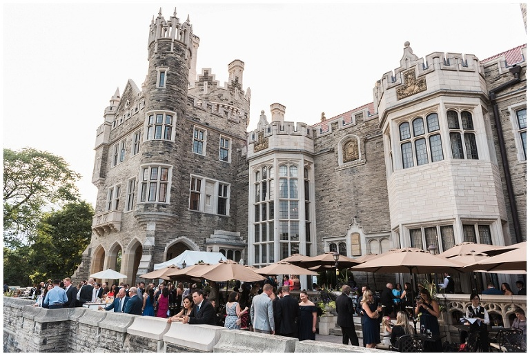 Guests enjoying the cocktail reception outside on the back patio of Casa Loma