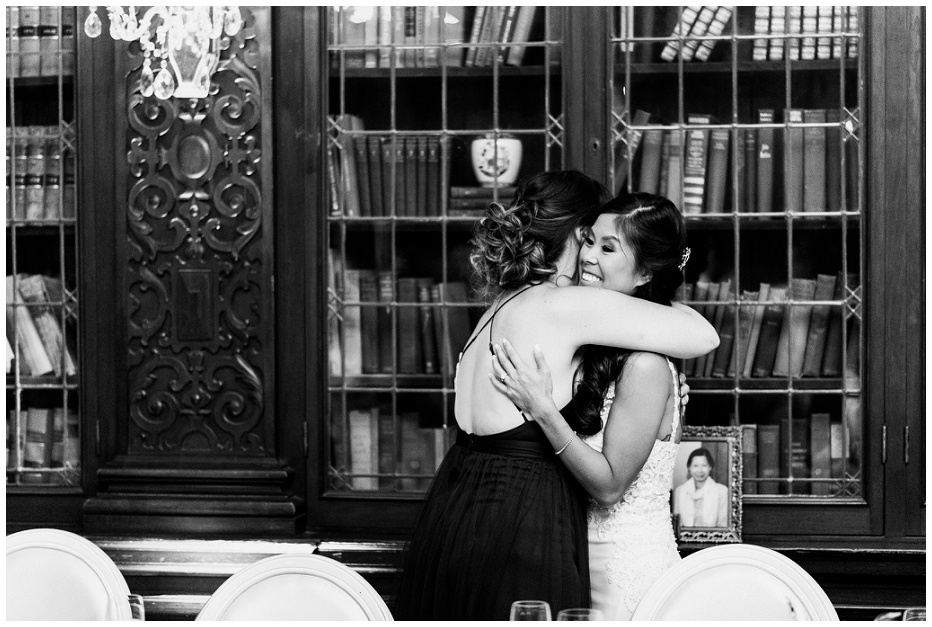 Bridesmaid hugging bride after wedding speech