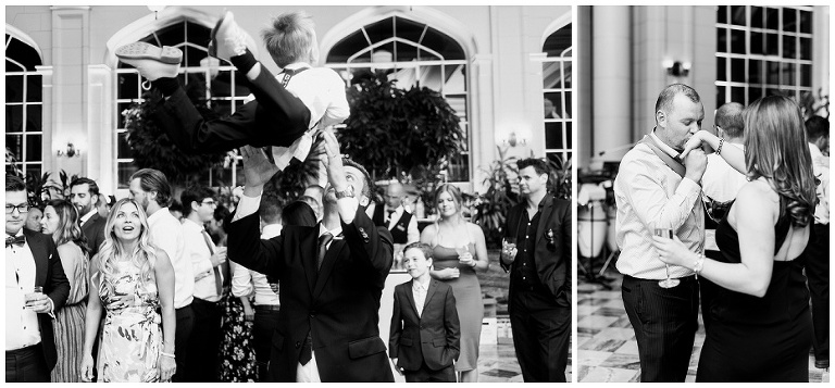 Groomsman throwing his son in the air at wedding reception