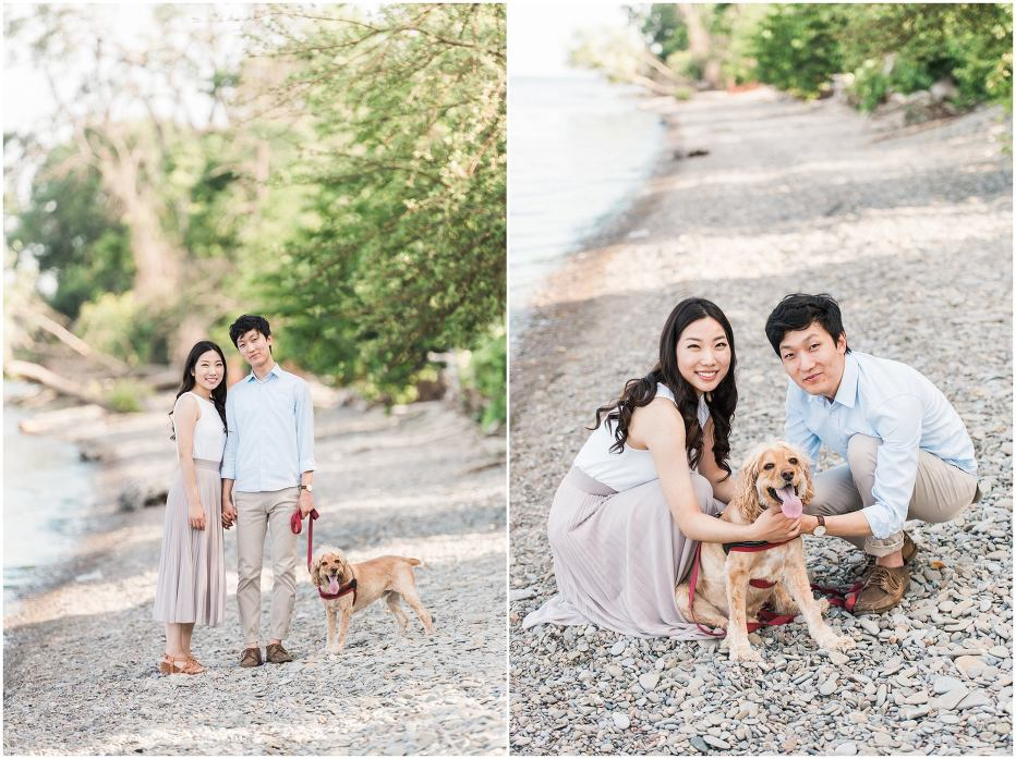 An asian couple walking on a pebble beach with their dog during their engagement session at Jack Darling Park