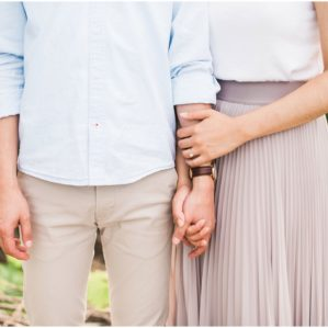 Close up of couple holding hands during their engagement session at Jack Darling Park